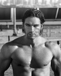23662932-black-and-white-portrait-of-a-hot-muscular-male-model-on-rooftop